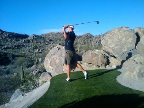 Todd finishes his swing in the desert
