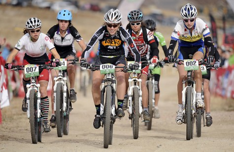Durango Composite's India Waller, far right, takes off with Varsity Girls