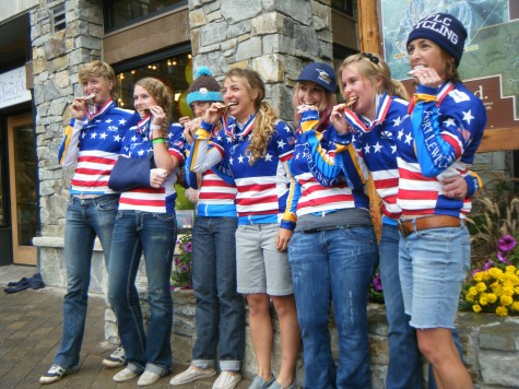 Coaches Sarah Sturm, 4th from left and Annie Cheeney, far right, take a bite into their Collegiate Team Gold Medal in California at the Collegiate National Championships