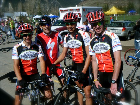 The mens RMCF Sweet Elite team poses with The Captain at the finish line