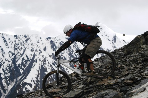 Miguel riding down mountains in Alaska