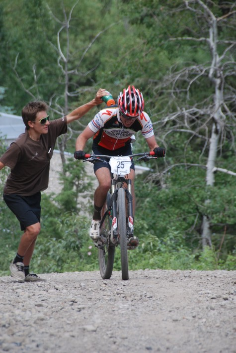 Devo U19er Levi is a nice teammate. Here he cools off RMCF/Devo Sweet Elite's Tad Elliott at last seasons National Championship Pro XC in SUn Valley. Tad went on to finish 6th!